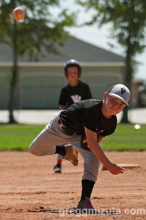 Colton Kesey pitches during the Snake River Slug Fest Baseball Tournament at Mesa Recreation Park in Fruitland, Idaho on July 27, 2013.