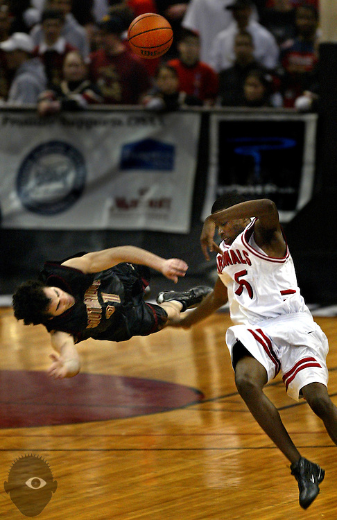 Southridge's Ryan DePalo (21) ends up horizontal to the floor after a collision with Lincoln's LaTravis Turner (15), both attempting to take possession of a long pass.  A foul was wrongly charged to Lincoln and DePalo left the game with a bloody nose.