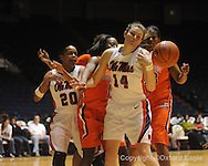"Auburn's Jordan Greenleaf (21), Mississippi's Kayla Melson, Auburn's Morgan Toles (1), and Mississippi's Elizabeth Robertson (14) battle for the ball in women's college basketball at the C.M. ""Tad"" SMith Coliseum in Oxford, Miss. on Thursday, February 25, 2010."