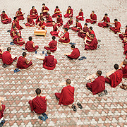 recitation of Wisdom Sutra in Dagpo Shedrup Ling, Kais, Himachal Pradesh,India.<br /> The Tibetan Buddhist monks line up in order of age with the youngest monk in the middle. The text is supposed to have great purifying power.