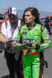 Fontana, CA/USA (Saturday, March 23, 2013) -  NASCAR Sprint Cup Series Driver Danica Patrick signs autographs for her fans at GoDaddy's garage at the Auto Club Speedway in Fontana, CA.  PHOTO © Eduardo E. Silva/SILVEX.PHOTOSHELTER.COM.