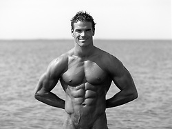 portrait of a hot bodybuilder at the beach