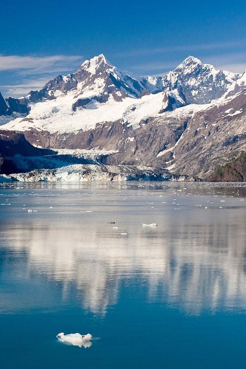 Mt. Orville and Mt. Wilbur shroud the Johns Hopkins Glacier in Glacier Bay.