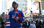 May 8, 2015 - New York, NY. A young Rangers fan prepares to walk into Madison Square Garden for game 5 of the Rangers-Capitals series.  Photograph by Anthony Kane/NYCity Photo Wire
