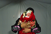A Syrian refugee woman holds a newborn baby girl named Lama at the french Gynécologie Sans Frontieres clinic at the Za'atri Syrian refugee camp in northern Jordan February 5,2013. (Photo by Heidi Levine/Sipa Press).