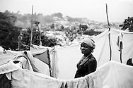 A woman stands in a tent city comprised of people displaced by the recent earthquake in Port-au-Prince, Haiti.