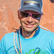 The voice of The Enormocast, climber Chris Kalous at the base of Castleton Tower