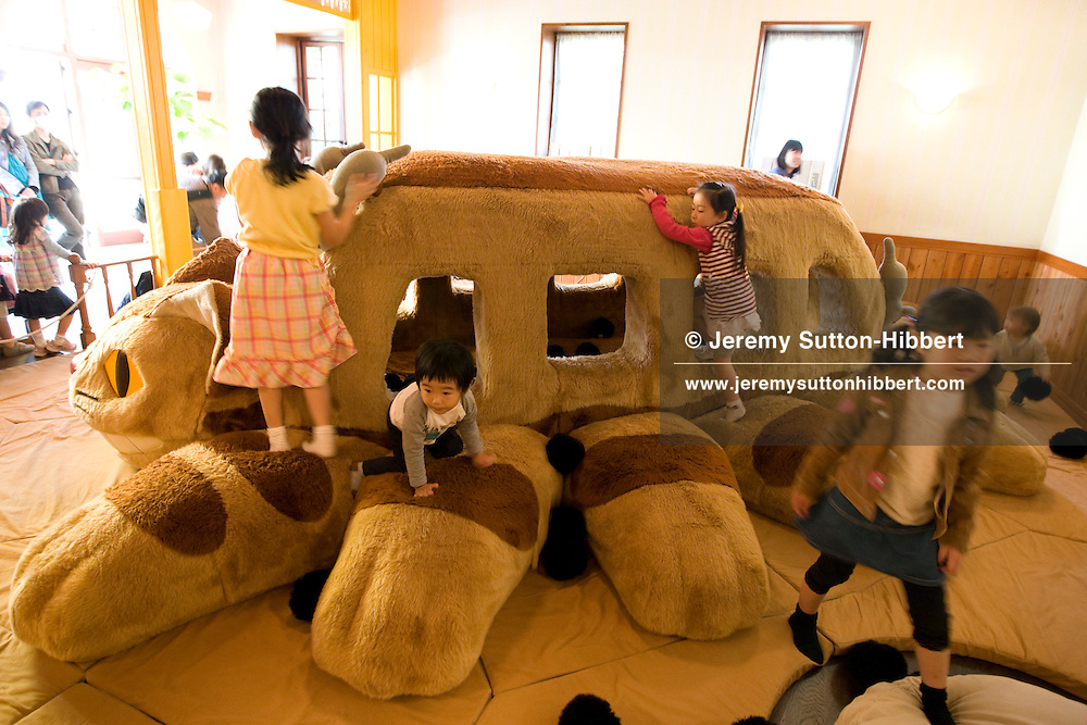 """Children play on the """"Cat Bus""""- a soft play-area recreation of a character from the animated film 'My Neighbour Totoro', inside Hayao Miyazaki's Ghibli Museum, in Tokyo, Japan. Wednesday 8th April 2009."""