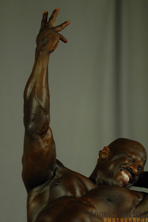 Gene Hendricks, of Chicago, Illinois, poses during the Physique (bodybuilding) competition 40-49 year old age group heavyweight division at McGaw Memorial Hall/Welsh-Ryan Arena at Northwestern University in Evanston, Illinois during the Gay Games VII competition on July 19, 2006. <br />  <br /> <br /> Hendricks finished third in the standard category of his division. <br /> <br /> Over 12,000 gay and lesbian athletes from 60 countries are in Chicago competing in 30 sports during the Games from July 15 through 22, 2006. <br /> <br /> Over 50,000 athletes have competed in the quadrennial Games since they were founded by Dr. Tom Wadell, a 1968 Olympic decathlete, and a group of friends in San Francisco in 1982, with the goal of using athletics to promote community building and social change. <br /> <br /> The Gay Games resemble the Olympics in structure, but the spirit is one of inclusion, rather than exclusivity. There are no qualifying events or minimum or maximum requirements.<br /> <br /> The Games have been held in Vancouver (1990), New York (1994), Amsterdam (1998), and Sydney (2002).