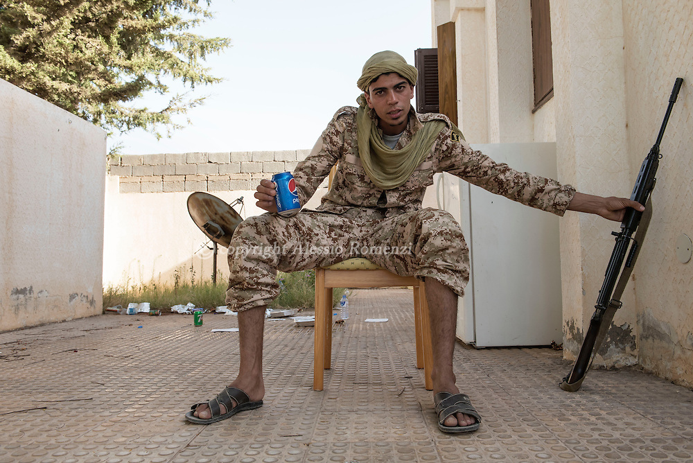 Libya: Fighter affiliated with Libya's Government of National Accord's (GNA) on the frontline with ISIS in 700 neighbourhood in Sirte. Alessio Romenzi