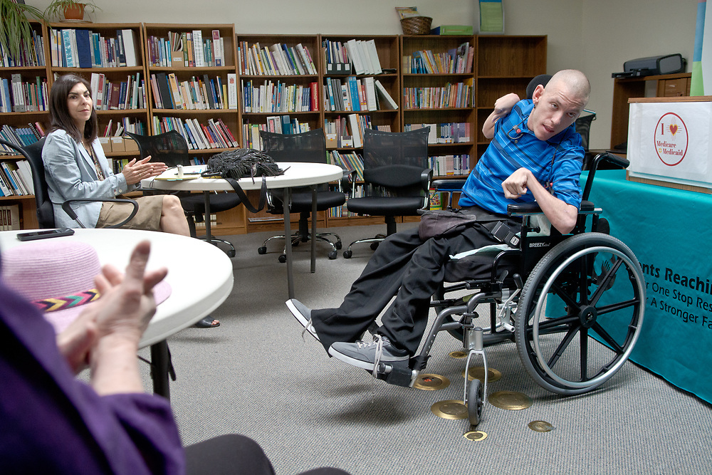mkb032217/metro/Marla Brose --  Adam Shand, right,  from Disability Rights New Mexico, speaks against repealing the Affordable Care Act (ACA) during a press conference hosted by Parents Reaching Out in Albuquerque, N.M., Wednesday, March 22, 2017, during which several organizations spoke in opposition to a bill that U.S. representatives will be voting on Thursday which would repeal the ACA. (Marla Brose/Albuquerque Journal)