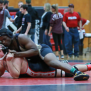 Newark Nazr Roberson and William Penn Dom Trotta grapple in a 220 pound bout during the Blue Hen Conference Wrestling Tournament Finals Saturday, Feb. 20, 2016 at William Penn High School in New Castle.