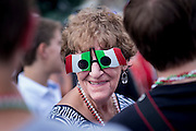 An woman shows off her Italian spirit during the 90th San Rocco Festa in Aliquippa. The festival, a three-day religious celebration, is held annually in August honoring St. Rocco, a patron saint of the city of Potenza, Italy where many Italians in Aliquippa can trace their ancestry.