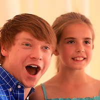 Actor Calum Worthy, left, poses for a photo with Kira Eldridge, 10, Sunday at the North Carolina Azalea Festival. (Jason A. Frizzelle)