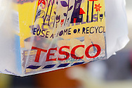 Person Hold a Tesco Carrier Bag - Apr 2015.