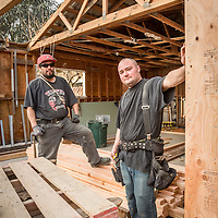 "Construction workers Jose Ramos and Jesse Lasorta work on a house project at Cedar and Lilly Streets in  Calistoga.  ""We live in San Francisco but we spend Monday through Friday here...we live in a trailer behind the project."""