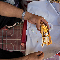 Carpet seller's breakfast. Hard boiled eggs tossed with red pepper, wrapped in pide. Van, Turkey