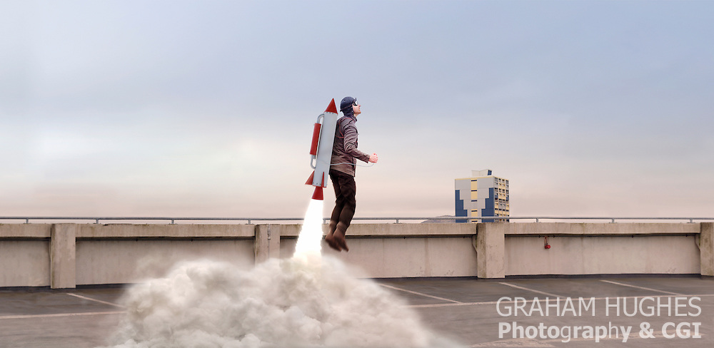 Model and background shot on location and CGI rocket, blast and smoke added in post production.