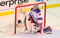 May 25, 2012; Newark, NJ, USA; New York Rangers goalie Henrik Lundqvist (30) kneels in his crease after a goal by New Jersey Devils center Ryan Carter (20) during the first period in game six of the 2012 Eastern Conference finals at the Prudential Center.