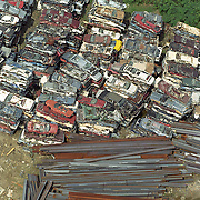 Aerial view: Crushed autos and steel beams at a scrap metal recycling facility NO PROPERTY RELEASE