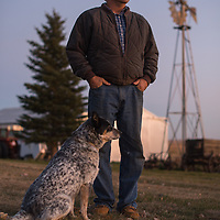 Farmer Steven Jensen stands in the front yard of his farm Princess, and Harley, (Harley not in frame), north of Tioga, N.D. Oct 24, 2013.  Over 20,000 barrels of crude oil poured out from the ground onto his farm across his North Dakota wheat field Sept 29. It took almost two weeks for officials to announce to the public about the break in the Tesoro Corp. pipeline located just north of Tioga. Photo Ken Cedeno