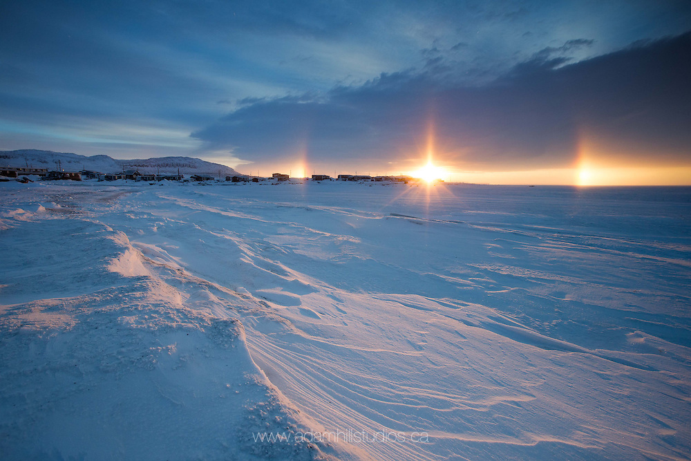 A sundog shows when the sunrise peaks at noon in Ulukhaktok, NT