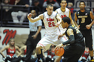 "Missouri's Jabari Brown (32) passes around Mississippi's Marshall Henderson (22) at the C.M. ""Tad"" Smith Coliseum in Oxford, Miss. on Saturday, February 8, 2014. (AP Photo/Oxford Eagle, Bruce Newman)"