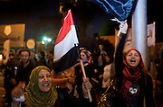 Egyptian women cheer in the district of Heliopolis upon hearing the news that Egyptian President Hosni Mubarak had stepped down February 11, 2011 following momentous marches on the public buildings across Cairo, Egypt. (Photo by Scott Nelson)