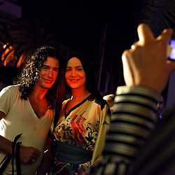 Jerome Philibert, a hairstyalist, and Noor, a transexual dancer, pose for a photo together during a party following one of the FestiMode fashion shows in Casablanca, Morocco on May 8, 2009.