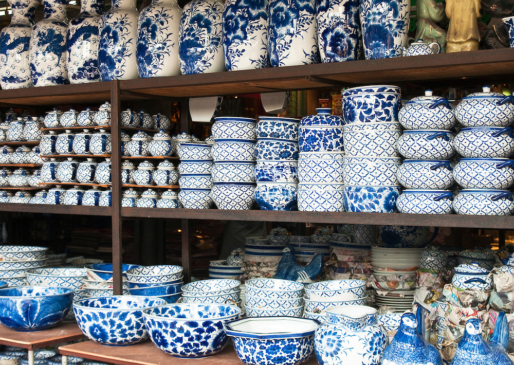 Thai made blue and white ceramic pottery for sale at Chatuchak Weekend Market in Bangkok, Thailand.