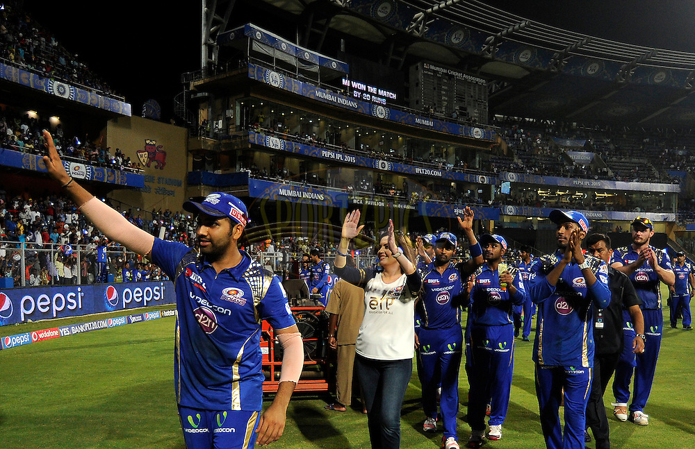 Nita Ambani owner along with Rohit Sharma captain and Team Mumbai Indians wave to the kids from the NGO education For All (EFA) an initiative from Mumbai Indians after match 23 of the Pepsi IPL 2015 (Indian Premier League) between The Mumbai Indians and The Sunrisers Hyferabad held at the Wankhede Stadium in Mumbai India on the 25th April 2015.<br /> <br /> Photo by:  Pal Pillai / SPORTZPICS / IPL