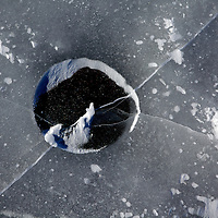 ".Project called ""Holes"" which features photos of ice fishing holes."