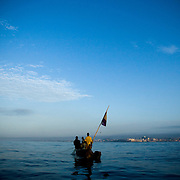 Fishermen pull in their catch into their small wooden boat a few hundred meters away from shore near Cape Coast, roughly 120km west of Ghana's capital Accra on Thursday April 9, 2009. Ghanaian fishermen have for generations harvested the ocean in a small-scale, sustainable way.
