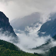 Storm clouds bringing heavy rain lift and swirl in the Mica Valley located near Revelstoke in British Columbia, Canada.