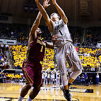 WEST LAFAYETTE, IN - MARCH 09: As Andre Hollins #1 of the Minnesota Golden Gophers guards Anthony Johnson #1 of the Purdue Boilermakers shoots the ball at Mackey Arena on March 9, 2013 in West Lafayette, Indiana.  (Photo by Michael Hickey/Getty Images) *** Local Caption *** Andre Hollins; Anthony Johnson
