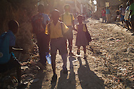 Port-au-Prince, HAITI, 23/03/2011: One year after the massive earthquake hit Haiti's capital, people try to recover their quotidian life, in the middle of a destructed city. Students in their way to school. (photo: Caio Guatelli)