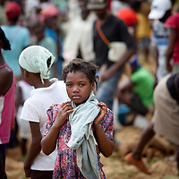 A girl with scarf stands out from the crowd in a market near Caye Michel in the Massif de la Hotte, Haiti