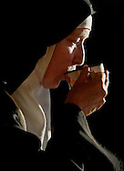 "BETHLEHEM, CONNECTICUT- FEB 2008: Mother Praxedes Baxter, O.S.B. from the Abbey of Regina Laudis in Bethlehem, Connecticut drinks a cup of tea while sitting in the Church of Jesu Fili Mariae. Mother Praxedes received the Mother Teresa Award from The St. Bernadette Institute of Sacred Art. The awards, according to the organization web site is to, ""recognize achievements which beautify the world"".  (Photo by Robert Falcetti). ."