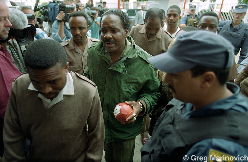 Johannesburg, South Africa: Convicted murdere and 'coach' of Mandela FC Jerry Richardson is brought to the hearings at which Winnie Madikizela-Mandela appeared at the Truth & Reconcilaition Council (TRC) hearing into Stompie Sepei's death at the hands of the so-called Mandela Football Club, 9th and final day, Mayfair.