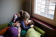 Divorced single mom Hind gets a kiss from her daughter Omaima. Antwerp, Belgium, 2012
