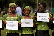 """African volunteers hold signs bearing the names of participating celebrities and VIP's  at a public tree planting ceremony sponsored by the Abuja Green Society in association with the ThisDay """"Africa Rising"""" Festival July 11, 2008 at the Abuja Central Park in Abuja, Nigeria. Celebrity guests of the festival, Super model Naomi Campbell and fashion designer Ozwald Boateng planted trees at the event, drawing attention to African environmental issues and providing an opportunity to project a positive image of Africa as part of the festival's larger focus.  ."""