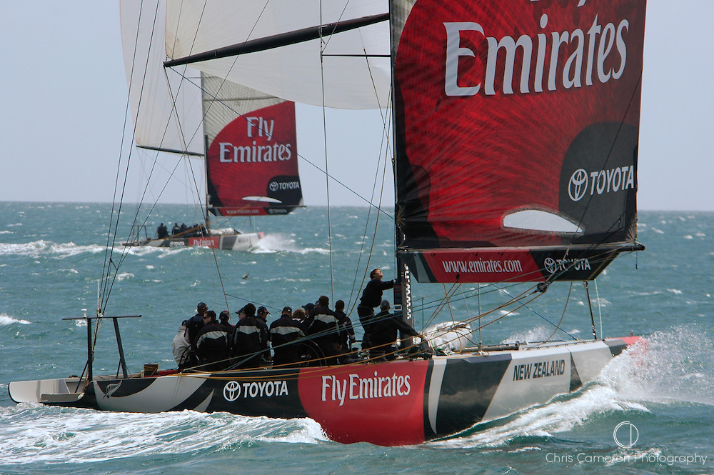 Emirates Team New Zealand sail ex Illbruck AC boat GER68 against NZL81 as part of their test program..(68 is closest to camera).Hauraki Gulf, Auckland. 17/12/2004