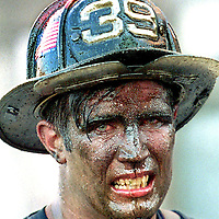 """""""Face of Courage""""      Boston firefighter John Nee of Engine Company 39, his face covered with oil soot and sweat, grimaces after walking out of a burning power plant fire.."""