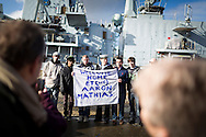 A rating poses for a family photograph after the type 23 frigate HMS Richmond returned to Portsmouth Royal Navy Base following a seven-month deployment to the South Atlantic. Picture date: Friday 21st February, 2014. Photo credit should read: Christopher Ison. Contact chrisison@mac.com 07544044177