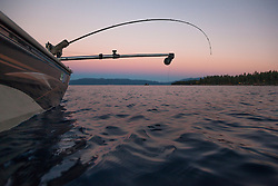 """Sunset Fishing on Lake Tahoe 9"" - Photograph of a fishing pole and downrigger at sunset on Lake Tahoe, on the East Shore."
