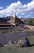Pilgrim relaxing by Dasha river..LAMBRANG MONASTERY IN XIAHE - CHINA.copyright: Androniki Christodoulou
