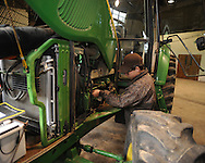 Lafayette High student Bram Billinsgly  troubleshoots tractor problems during the Northwest Federation FFA District Competitions at The Oxford-Lafayette School of Applied Technology on Friday, March 12, 2010. OLSAT expected over 274 students, advisors, parents, and visitors on campus.