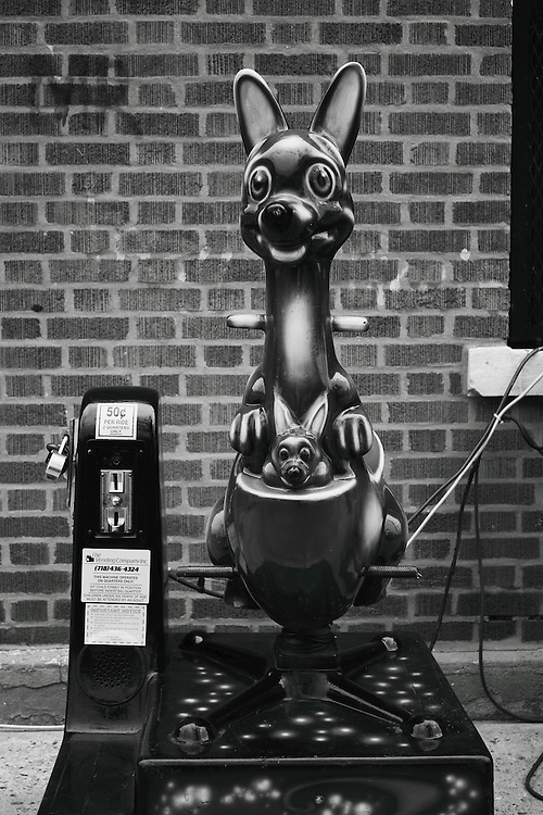 This eerily happy coin operated Kangaroo ride sat ominously out of place in front of a grimy industrial welding shop in Queens, New York. The power chord running haphazardly through the adjacent window suggested it was some kind of snare intended to capture wandering neighborhood children.