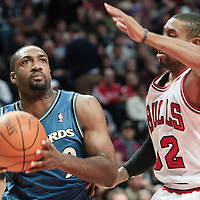 13 November 2010: Washington Wizards' point guard #9 Gilbert Arenas drives past Chicago Bulls' point guard #32 C.J. Watson during the Chicago Bulls 103-96 victory over the Washington Wizards at the United Center, in Chicago, Illinois, USA.