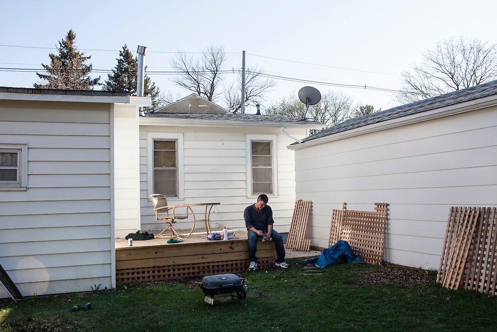 Steve McFarland sits on his back deck on Friday, March 23, 2012 in Webster City, IA.